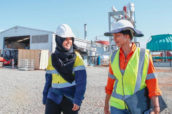 2 women in safety gear