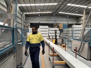 Man walking through factory